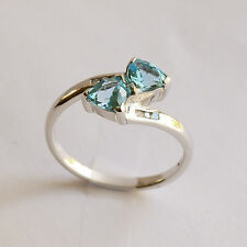 BLUE TOPAZ RING. PRETTY BLUE STONES PLUS 6 DIAMONDS IN 9K WHITE GOLD. SIZE M.