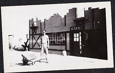 Old Antique Vintage Photograph Shirtless Man With Wheel Barrel In Front of Cafe