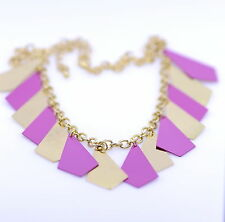 Very cool gold and pink chandelier tassel necklace