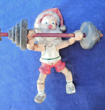 ANTIQUE WOODEN SANTA FIGURE WITH BARBELLS 4 1/2""