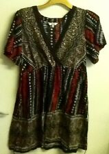 m&co black tunic top with red white print. metal embellishments small