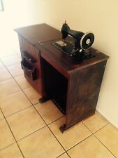 Adler treddle operated sewing machine in timber cabinet