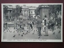 POSTCARD LONDON LIFE NO 5 POSING FOR A PHOTO WITH PIGEONS IN TRAFALGAR SQUARE