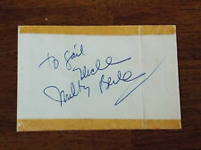 UNCLE MILTON BERLE SIGNED 3X4 BACK OF TABLE RESERVATION CARD