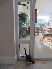 CAT door, Vertical window, white vinyl, Flap 7x 10 opening up to 25 lbs.31-34 Lg