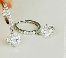 Silver hanging Diamond style earrings like diamond ring