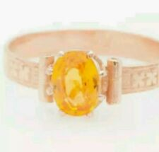 Genuine 1 full carat yellow sapphire set in a 14kt. rose gold setting