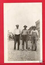 RPPC 3 MEN STANDING IN A STREET SUSPENDERS BIB OVERALLS BEER BOTTLE SODA BOTTLE