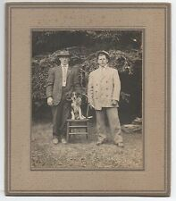 1920s Photo of two Men with their Terrier Dog sitting on Chair