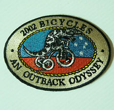VINTAGE 2002 BICYCLES OUTBACK ODYSSEY SOUVENIR PATCH WOVEN CLOTH SEW-ON BADGE