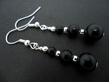 A PAIR OF DANGLY BLACK ONYX  SILVER PLATED EARRINGS.