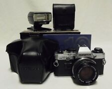 OLYMPUS OM10 35mm SLR Film Camera w/50mm Lens, Case, T-20 Flash, Manuals & Box