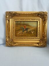 Small oil of a hunting scene - Horse, rider and dogs. Mounted in a gilt frame