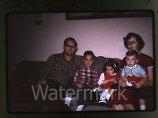 1960s  amateur Kodachrome Photo slide family sitting on couch