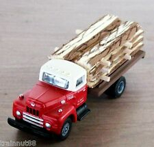 HO Classic Metal Works Red & White Undec  6 wh Truck with Rough Cut Lumber Load