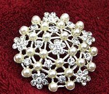 Vintage Art Deco silver clear crystal frozen snowflake brooch