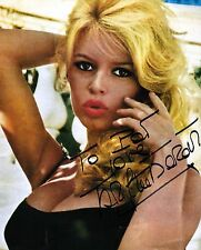 Brigitte Bardot signed sexy 8x10 calendar page / autograph to Pat minor wrinkles