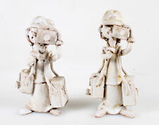 SET OF TWO POTTERY STATUES OF YOUNG PHOTOGRAPHERS BY DINO BENCINI