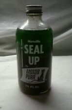 VINTAGE 7 1/2 OZ BOTTLE OF JONES MOTOR PURR  SEAL UP