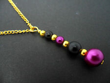 A PURPLE & BLACK GLASS PEARL  GOLD PLATED PENDANT NECKLACE. NEW.