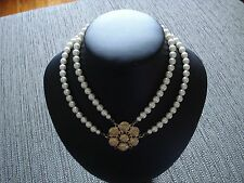 Vintage white pearl necklace with gold metal brooch in centre