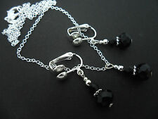 A SILVER PLATED BLACK CRYSTAL  NECKLACE AND  CLIP ON EARRING SET. NEW.