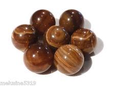 lithothérapie une sphere onyx pierre boule de massage soins reiki