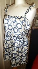 Stunning BNWT JUICY COUTURE Silk Blue Circle Date Top Size 4