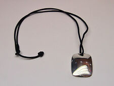 Tiffany & Co. 925 Sterling Silver Pendant with black wire