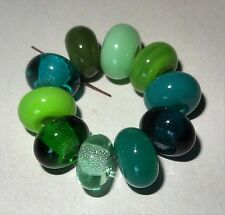 10 MULTI GREEN TONE SPACER LAMPWORK BEADS SRA