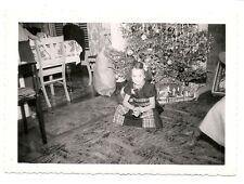 Great vintage Christmas snapshot young girl sitting in front of Christmas tree