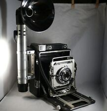 Graflex Crown Graphic 4 x 5 with135mm Optar f4.7 lens with flash & reflecter