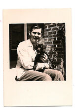Black and white original vintage photo of a man and dog from the 1940's-1950's