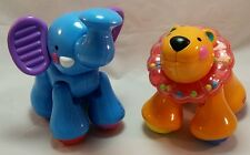 """Fisher Price Amazing Animals 6"""" Lion And Elephant Clicking Rattling Animal Toy"""