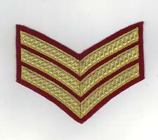 BRITISH ARMY SERGEANTS DRESS INSIGNIA/CHEVRON FOR NO 1 DRESS GOLD ON PARA MAROON