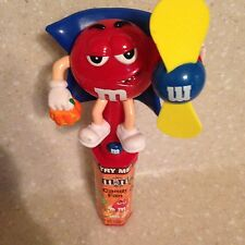 """NEW 7 1/4"""" Plastic M&Ms Candy Red Halloween Superhero Toy. Working Handheld Fan."""