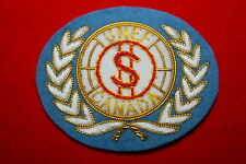UNITED NATIONS UN BULLION WIRE BREAST BADGE CANADIAN CANADA PAYMASTER FINANCE