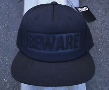 GRIZZLY GRIPTALE X SUPPLY CO. BEWARE BLACK SNAPBACK HAT