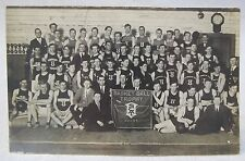 1920's BASKETBALL TEAMS holding SCAL TROPHY banner RPPC real photo postcard