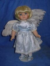 The Heritage Heirloom Collection Porcelain Doll with Angel Wings and Stand