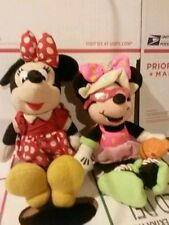 2 Minnie Mouse plushies. Medium. Soft and cuddly. Disney Store.