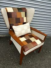 Parker Knoll Wing back  chair newly upholstered in  genuine leather patcwork