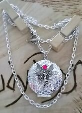Lovely, round Fairy locket necklace  holds 2 pics
