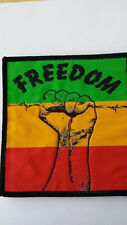 Freedom from oppression Clenched Fist Cloth Sew-On Patch 11cm High by 10cm Wide