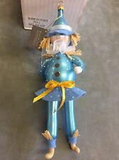 DE CARLINI ORNAMENT, OM4425 Pale Blue Scarecrow W/Raffia Accents New In Box,9""