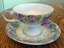 VINTAGE TEACUP AND SAUCER IN A BEAUTIFUL FLORAL DESIGN PATTERN GOLD TRIM