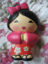 Japanese Doll with large bow in hair