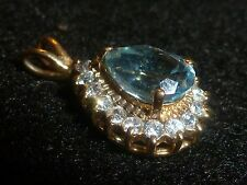 PRETTY 10K SOLID GOLD PEAR-SHAPED BLUE TOPAZ AND CLEAR STONE PERIMETER PENDANT