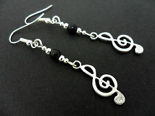 A PAIR OF TIBETAN SILVER MUSICAL NOTE TREBLE CLEF THEMED EARRINGS. NEW.