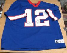 TWICE SIGNED JIM KELLY BUFFALO BILLS JERSEY FROM 2 DIFFERENT YEARS OF JKFC